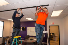 Crew Installing Heavy Glass Wall