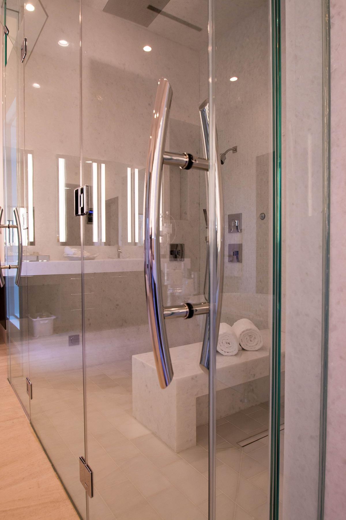 Henderson sunwest custom homes residential glass project a custom shower door handles planetlyrics Choice Image