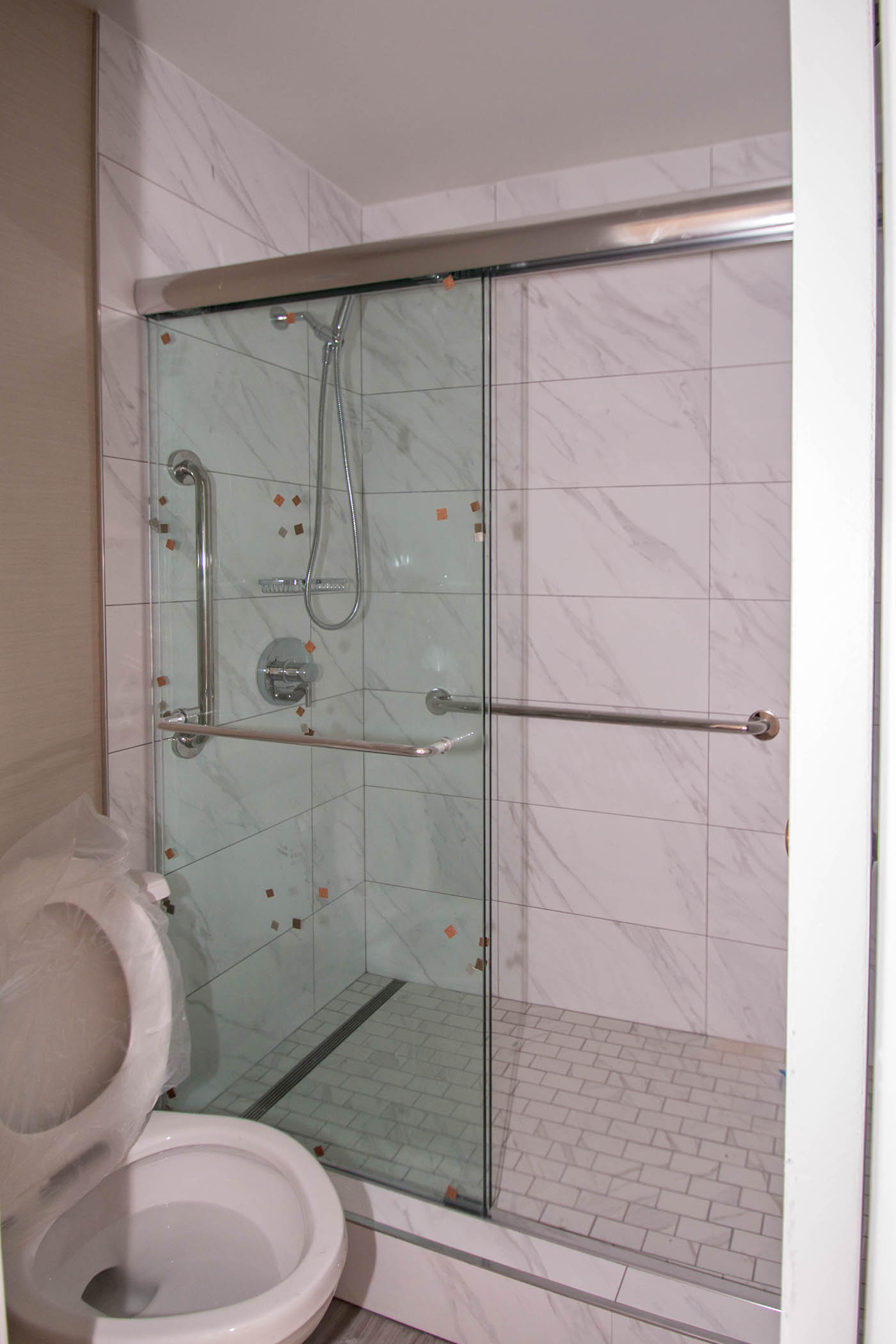 Close Up Of California Hotel Custom Shower Door Enclosure Installation